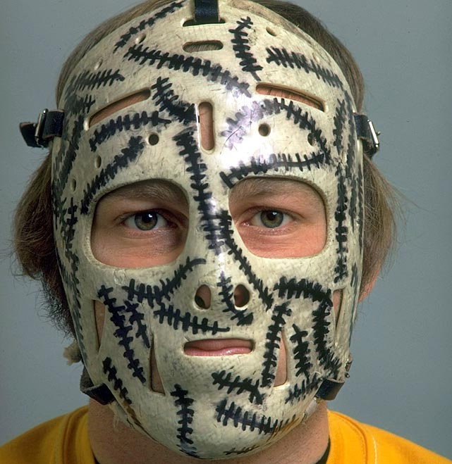 "Arguably the single most recognizable mask of all time, the story goes Bruins trainer John ""Frosty"" Forristall drew a huge black stitch mark, at Cheevers' request, where the puck had struck his mask during a practice, leaving his teammates in stitches. However, Cheevers had tried the stitches gag at least once before in the late '60s. Regardless, it was a hit with his teammates, fans and the media, and Cheevers continued to add stitches to his mask every time a puck struck it."