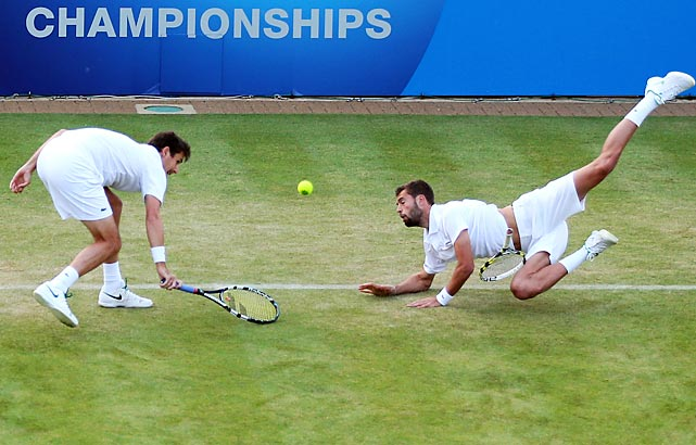 France's Edouard Roger-Vasselin (left) and Benoit Paire dive for a ball in their doubles second-round match against Great Britain's Colin Fleming and Jonathan Marray during the AEGON Championships at Queens Club in London, England. Fleming and Marray won.