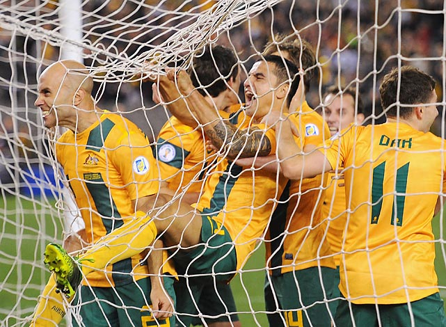 Mark Bresciano of Australia is congratulated by teammates after scoring during their 2014 FIFA World Cup Qualifier vs. Jordan in Melbourne.
