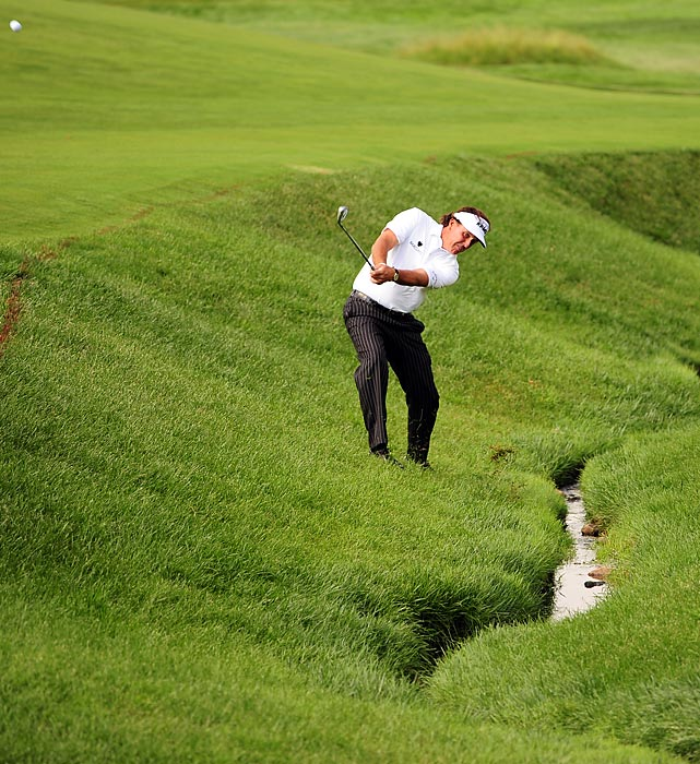 Phil Mickelson drives a ball out of the rough during Round 2 of the U.S. Open.