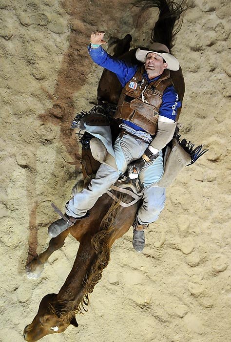 Stuart Frame of Monto competes Bareback Bronc Riding during the National Rodeo Finals on the Gold Coast, Australia.