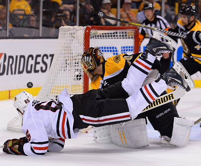 Chicago's Andrew Shaw, the hero of the triple-OT Game 1, gets tripped up as the puck sails wide of Boston's net. The Blackhawks offense suffered from the loss of their leading playoff scorer, Marian Hossa, who was scratched after warm-ups due to an upper body injury.