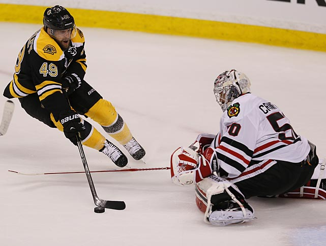 Chicago goaltender Corey Crawford stops Boston's Rich Peverley. The Bruins seemed energized by their come-from-behind overtime win in Game 2.