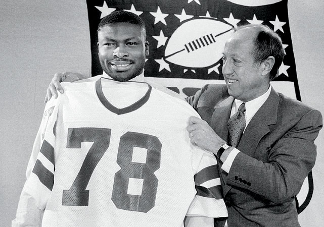 NFL commissioner Pete Rozelle fits Smith for his new jersey during the NFL Draft on April 20.