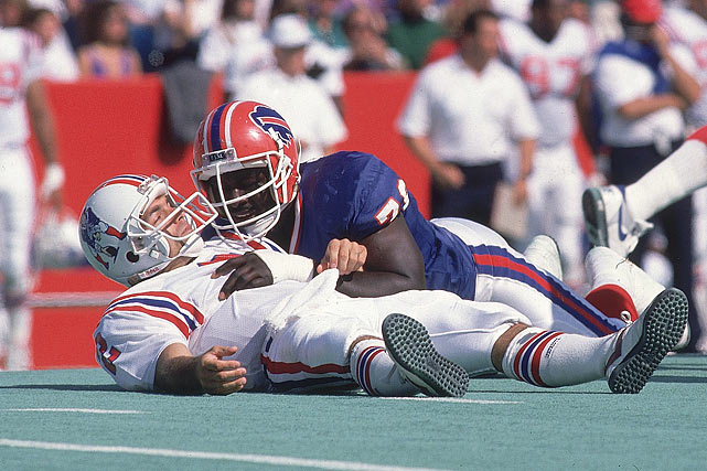 Smith takes down Patriots QB Doug Flutie on Oct. 1.
