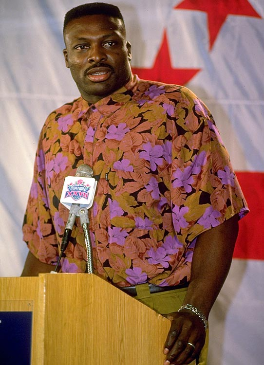 Smith addresses the media before Super Bowl XXVII.