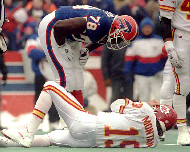 Smith leans over Chiefs QB Joe Montana. Smith's tackle caused a concussion, forcing Montana to leave the game.