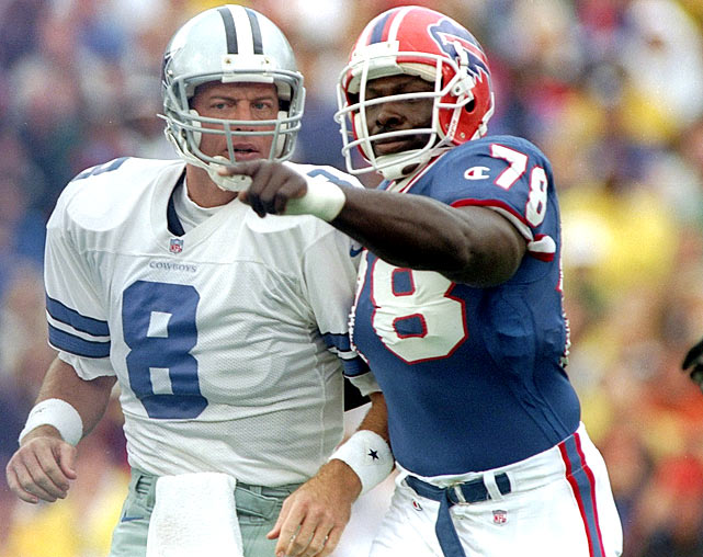 Cowboys QB Troy Aikman and Smith converse during a Bills victory on Sept. 22.