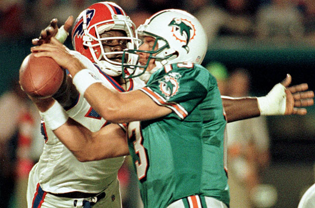 Smith wallops Dolphins QB Dan Marino in a Nov. 17 game.