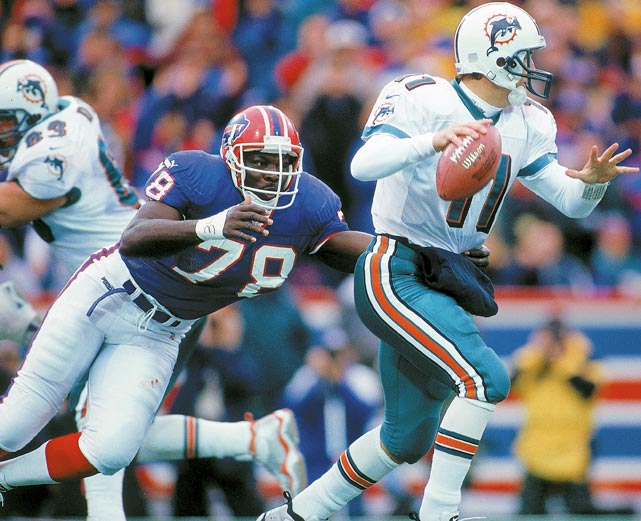 About to make a sack, Smith lunges toward Dolphins QB Damon Huard.