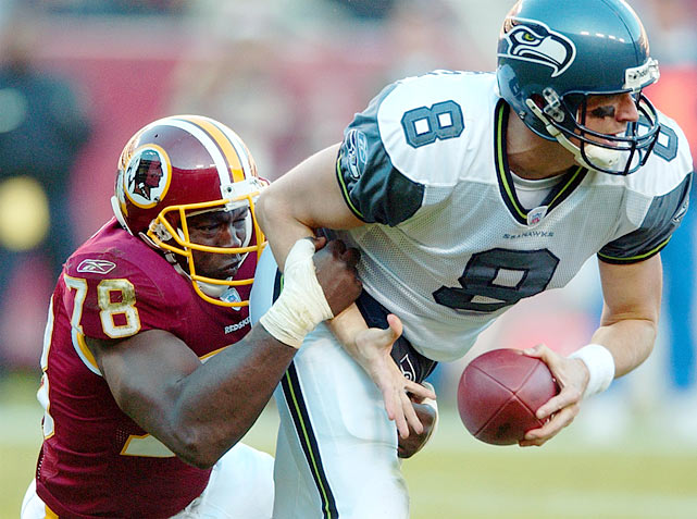 Smith sacks the Seahawks' Hasselbeck in a 27-20 Redskins win. The sack placed Smith half a sack behind Reggie White's all-time record.