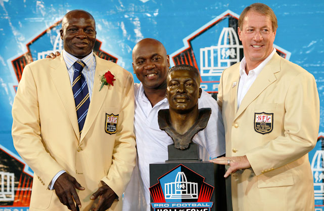 Smith with former Bills teammates Thurman Thomas and Jim Kelly following his 2009 Hall of Fame induction. Smith's 200 career sacks are an all-time NFL record.