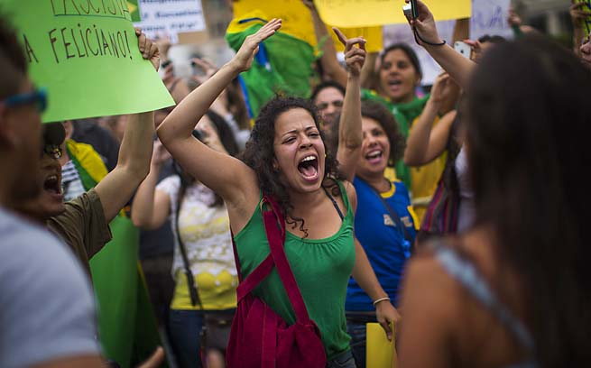 Brazilian protesters shout slogans against the Brazilian government during a demonstration in Barcelona, Spain, on Tuesday.