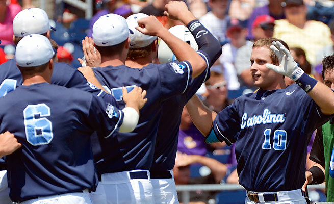Brian Holberton is greeted by his teammates after his first-inning home run gave the Tar Heels a 2-0 lead.
