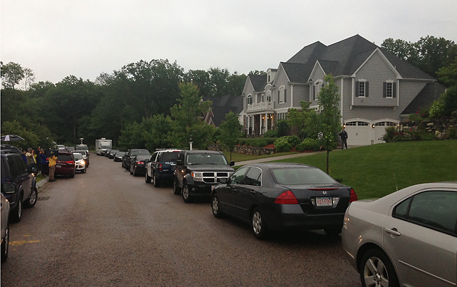 One unmarked police car blocked Hernandez's driveway before ten police cruisers eventually arrived to search the home.
