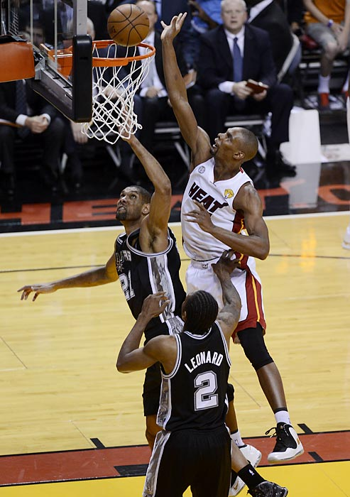 Miami's Chris Bosh (right) attempts a put-back over San Antonio's Tim Duncan and Kawhi Leonard.