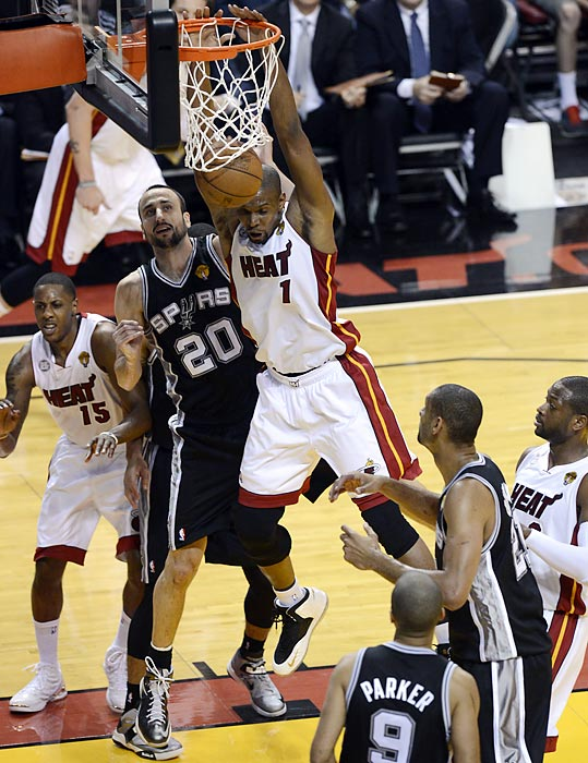 Miami's Chris Bosh (1) finishes past San Antonio's Manu Ginobili. Bosh totaled 10 points and 11 rebounds in 39 minutes.