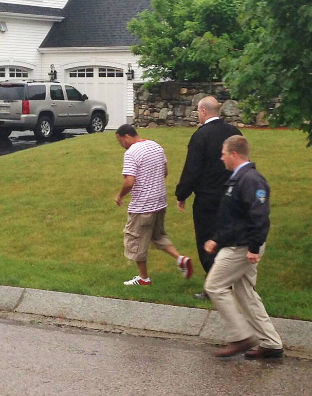 The second man was escorted out by police after questioning why the driveway was blocked.
