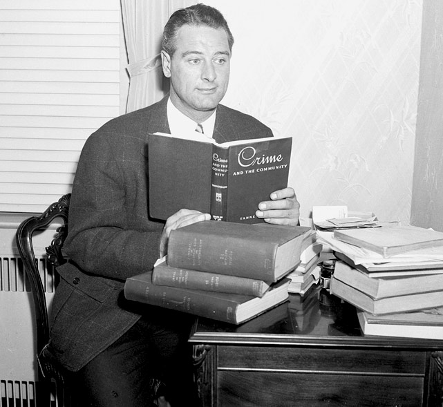 Upon retiring from baseball, Gehrig accepted the post of City Parole Commissioner. Here, in Oct. 1939, he studies books on crime to prepare for the job.