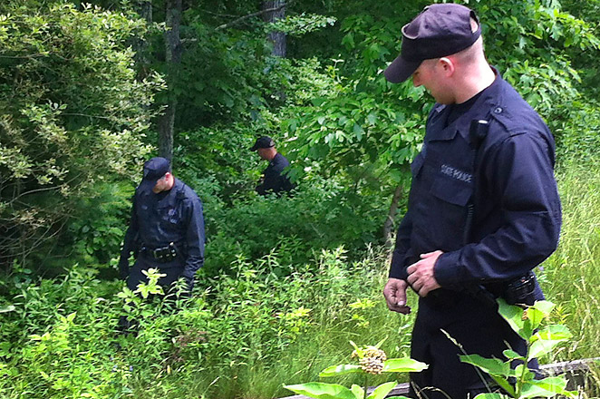 Massachusetts State Police searched near the home of Aaron Hernandez after a body was found nearby.