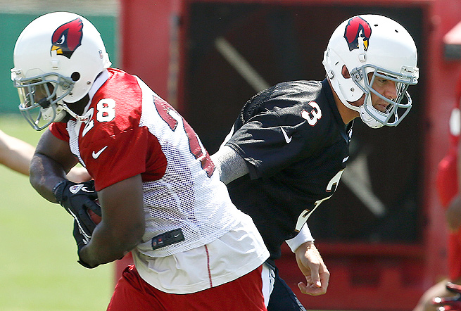 Rashard Mendenhall was named the Cardinals' starter after running with the first team in OTAs.