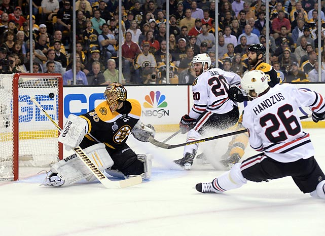 Michal Handzus opened the scoring with a shorthanded goal at 6:48 of the first period, snapping Tuukka Rask's shutout streak at 129:14. Handzus later assisted on Marcus Kruger's second period tally that gave Chicago a short-lived 4-2 lead.