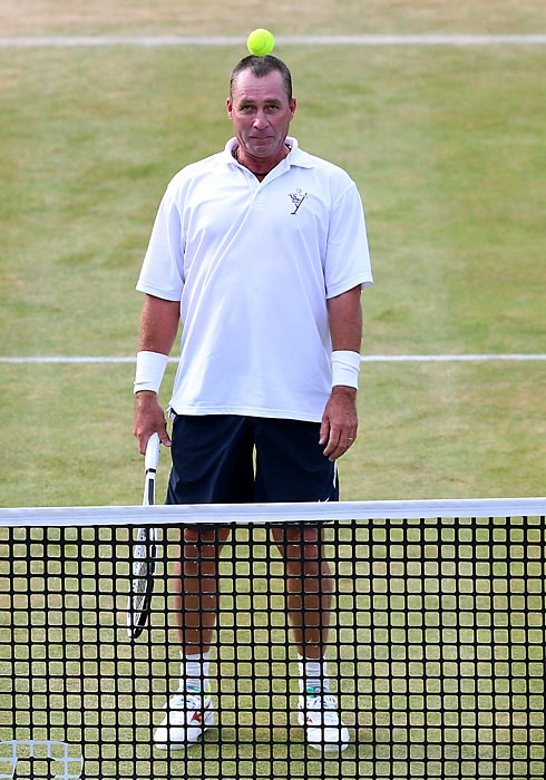 The former tennis great as sharp as ever during the Rally Against Cancer charity match at Queens Club in London.