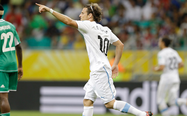 Diego Forlan assisted on Uruguay's first goal, then scored the game-winner to beat Nigeria.