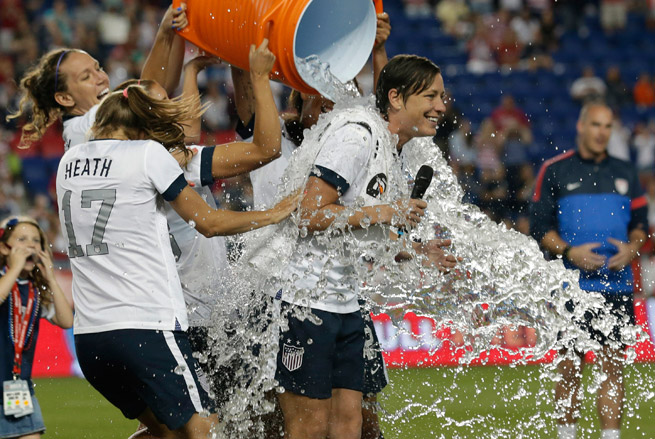 Abby Wambach's teammates gave her a celebratory Gatorade shower after her record-breaking night.