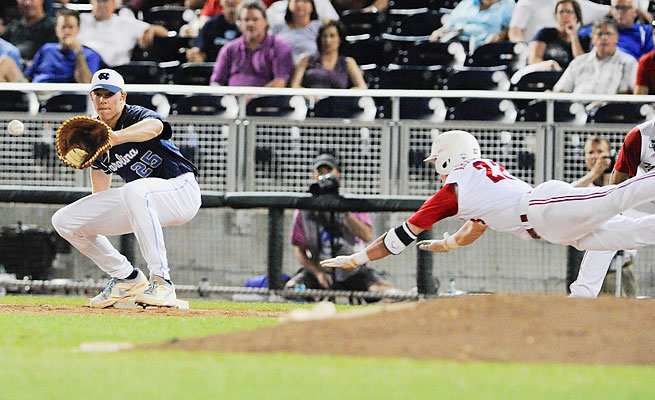 North Carolina first baseman Cody Stubbs catches a throw ahead of NC State's Jake Armstrong during UNC's win.