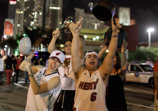 Miami Heat fans celebrated in the streets after their team beat San Antonio in Game 7 of the NBA Finals.