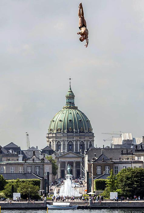 David Colturi of the USA dives from the 28-meter platform on the roof of the Copenhagen Opera House during a practice session.