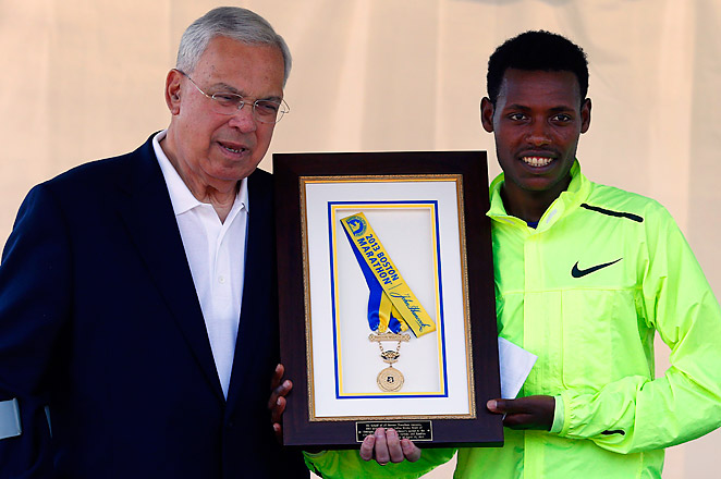 Lelisa Desisa of Ethiopia returned his medal to Mayor Thomas Menino to honor the city of Boston.