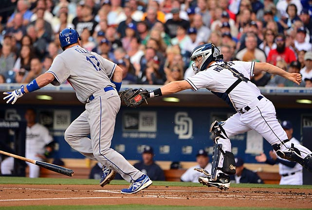 San Diego Padres catcher Nick Hundley attempts to tag the Los Angeles Dodgers' A.J. Ellis after a dropped ball on a third-strike swing. The Padres won 5-2
