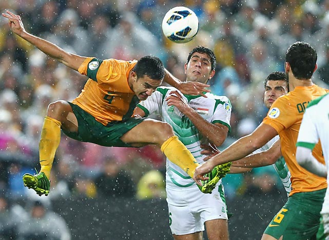 Tim Cahill of Australia heads the ball during a 2014 World Cup Qualifier with Iraq in Sydney.