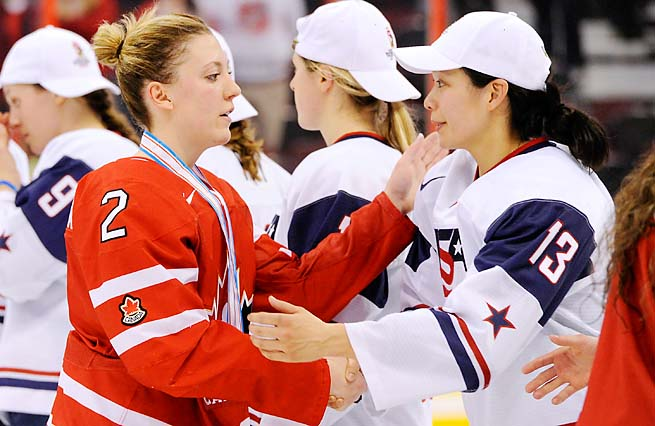 Julie Chu (right) and the U.S. women beat Canada for the world championship in April.