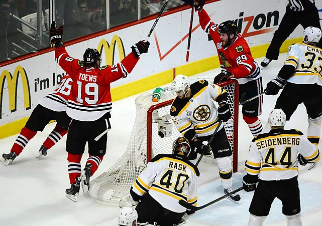 Tuukka Rask (40), Patrick Kane (88) and Jonathan Toews (19) celebrate a goal during Game 5 of the Stanley Cup Finals.