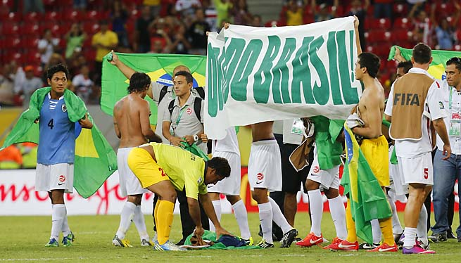 Tahiti players thank Brazil after their last match at the Confederations Cup.