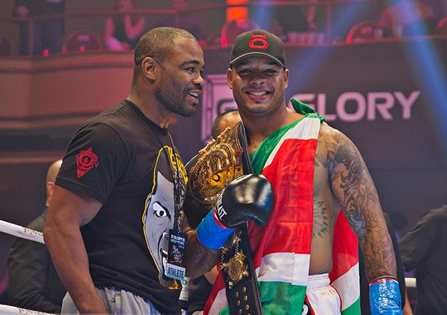 Spong holding his belt, with Rashad Evans.