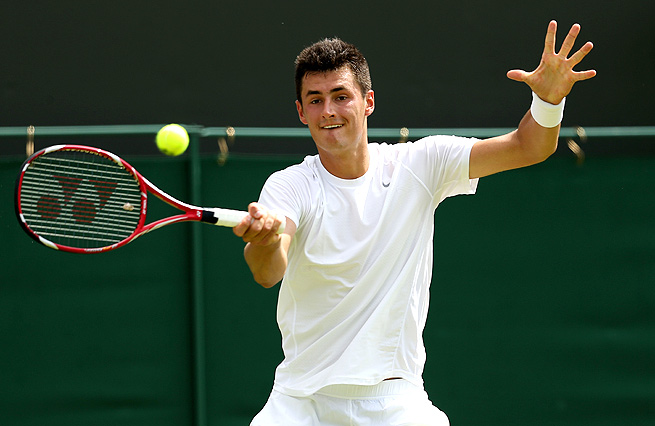 Bernard Tomic overcame a tough, five-set match to beat Sam Querrey in the first round at Wimbledon.