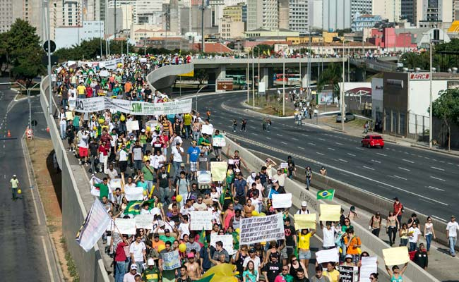 Thousands of demonstrators have marched on the stadium that is hosting the Brazil vs. Uruguay match.