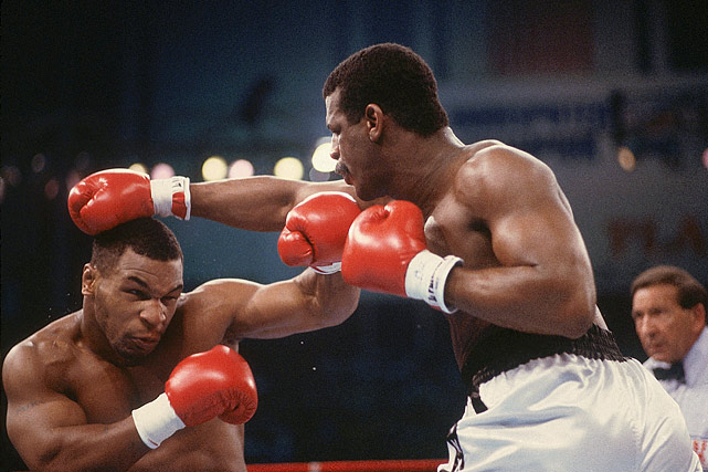 Tyson was aggressive from the get-go, landing a powerful left hook and putting Spinks on the defensive.