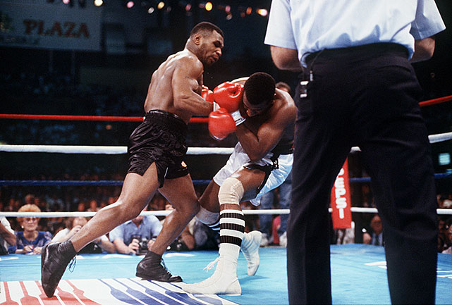 Spinks never fully recovered. A furious left-right combination to the head put Spinks out for good.