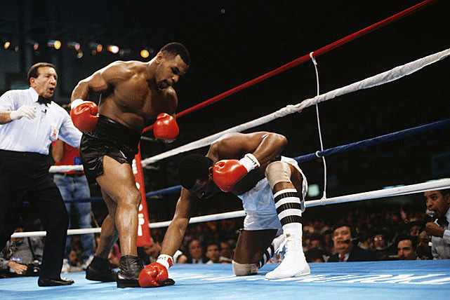 A left uppercut and a right punch to the body forced Spinks to kneel down and re-gather himself. Referee Frank Cappuccino attempted to hold Tyson back.