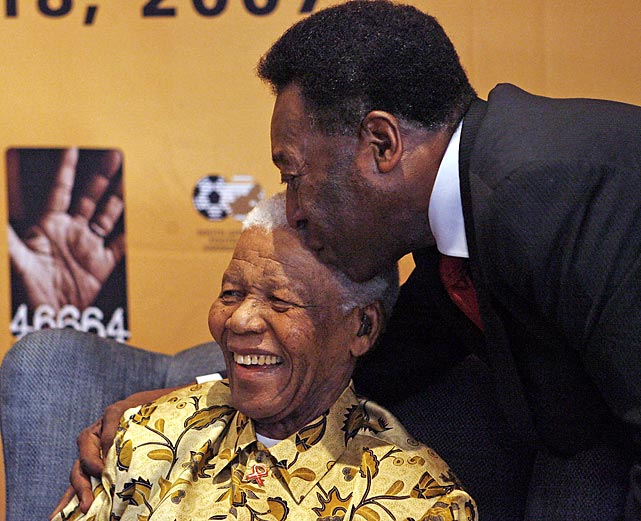 "Brazilian football legend Pele greets Mandela the day before his 89th birthday. The ""90 Minutes for Mandela"" match, which Pele attended, was played the following day."