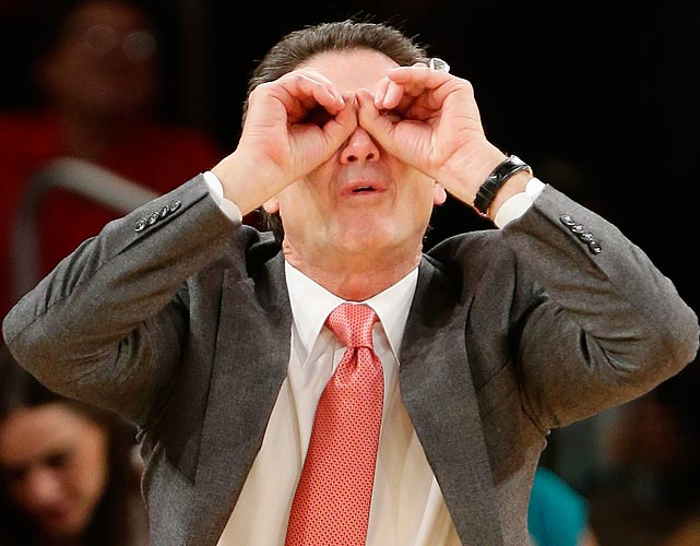 Did You See That? Louisville's coach surely did with his cutting edge high-tech binoculars.