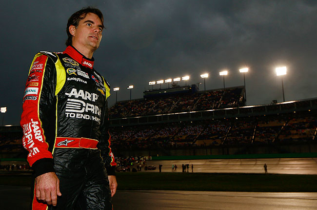 Jeff Gordon looks on as rain forces the circuit's first postponement since last year's Daytona 500.