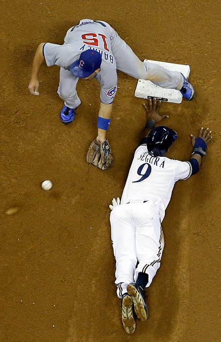 The Milwaukee Brewers' Jean Segura steals second base with Chicago Cubs second baseman Darwin Barney covering during the sixth inning of a 5-4 Cubs win.