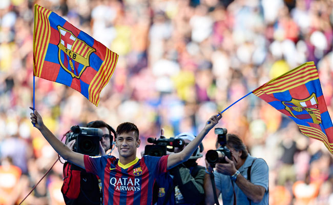 Neymar waves to fans during his official presentation at Barcelona's Camp Nou in June.