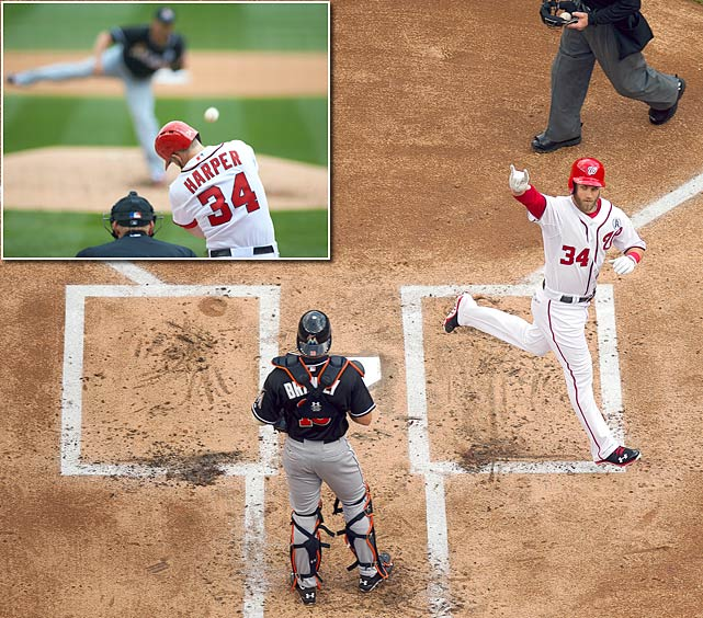 All it took was two at-bats on his first opening day in the majors for Harper to hit two homers - and hear some ''M-V-P!'' chants. Both solo shots were the only runs scored in the entire game as the Nats beat the Marlins 2-0.